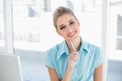 Stock Photo of Smiling smart businesswoman posing
