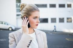 Stock Photo of Thoughtful stylish businesswoman having a phone call