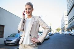 Cheerful elegant businesswoman on the phone Stock Photos