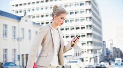 Stock Photo of Focused gorgeous businesswoman text messaging