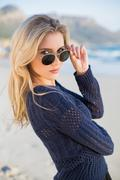 Attractive casual blonde looking over her sunglasses - stock photo