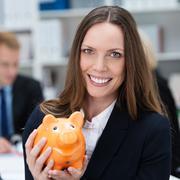 Business woman with a piggy bank Stock Photos