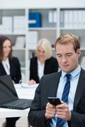 businessman reading a text message - stock photo