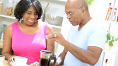 Mature African American Couple Preparing Fresh Coffee Stock Footage
