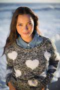 Smiling gorgeous woman with pullover posing - stock photo