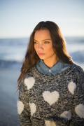 Pensive gorgeous woman with pullover posing - stock photo
