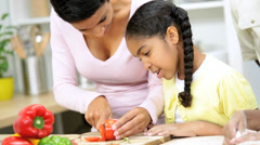 Ethnic Mother Young Daughter Kitchen Slicing Vegetables Stock Footage