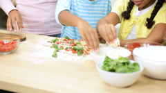 Cute Ethnic Girls Being Helped Make Lunch Pizza Stock Footage