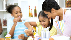 Young Ethnic Girls Icing Cakes Kitchen Mother Close Up Stock Footage