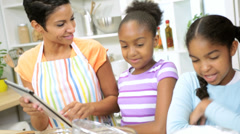 Online Wireless Tablet Recipe African American Females Kitchen Stock Footage