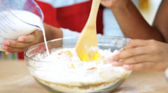 Close Up Hands Ethnic Girls Baking Lesson No Faces Stock Footage