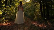 Stock Video Footage of Young Woman in Vintage Wedding Dress walking Forest Background