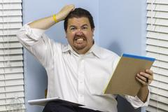 angry with work - stock photo