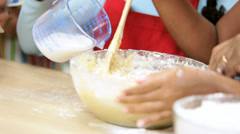Ethnic Mom Wireless Tablet Recipe Baking Young Girls Stock Footage