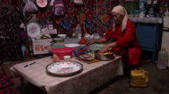 Woman prepares fresh meal in a yurt in Kyrgyzstan Stock Footage
