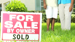 Senior African American Couple Outside New Home Stock Footage