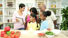 Three Generations Ethnic Family Kitchen Wireless Tablet Stock Footage