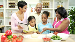 African American Family Kitchen Tablet Food Websites - stock footage