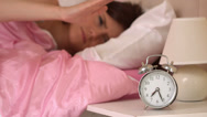 Stock Video Footage of Irritated young woman throwing her ringing alarm clock