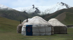 Yurt camp in rough mountain setting in Central Asia Stock Footage
