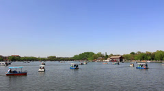 Taking boat on the lake,Beihai park,Beijing Stock Footage