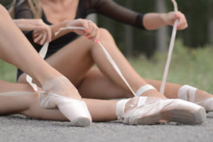 Two female ballerinas getting ready Stock Footage