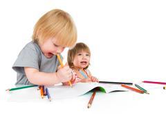Children draws pencil Stock Photos