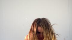 Beautiful blonde woman rising Stock Footage