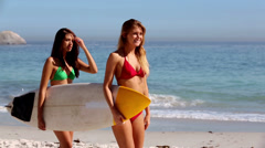 Friends walking with a surfboard Stock Footage