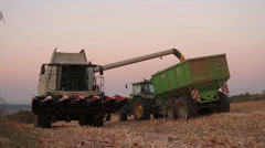 Harvester Pouring Seed into Truck Field Corn Harvest Concept HD Stock Footage