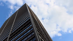 Office Tower With Moving Sky Stock Footage