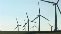Wind turbines and sun - stock footage
