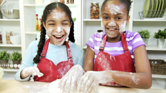 Smiling African American Sisters Playful Baking Flour Stock Footage