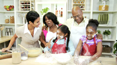 Working African American Mom Looking Daughters Cake Mixture - stock footage