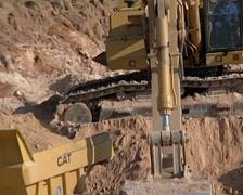 Cat Excavator loading haul trucks PAL - stock footage