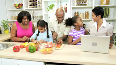 Stock Video Footage of Busy Ethnic Family Kitchen Mom Wireless Laptop