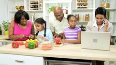 African American Grandparents Children Kitchen Mom Working - stock footage