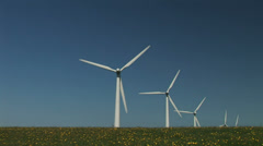 Wind turbines on field and flowers Stock Footage