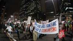 People protest on Avenida Paulista against communism and president Stock Footage