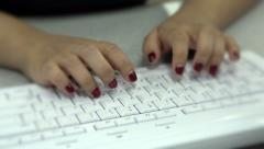 Female typing at white keyboard Stock Footage