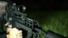Soldier holding gun slow motion Stock Footage