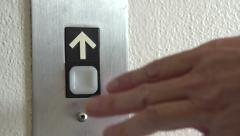 Pressing up arrow at elevator - stock footage