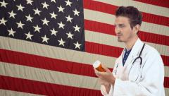 Doctor with pills on American Flag background Stock Footage