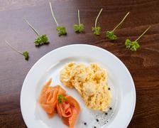 Salmon and scrambled eggs Stock Photos