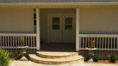 Steps to front door of house Stock Footage