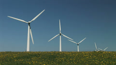 Flowers grass and wind turbines - stock footage