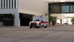 Ambulance goes by in downtown Houston - stock footage