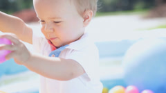 Close Up Happy Baby Boy Playing Ball Filled  Pool Stock Footage