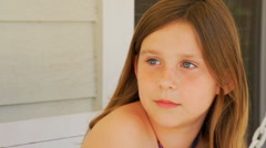 Girl glances at camera and laughs Stock Footage