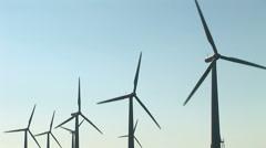 Wind turbine and sun - stock footage